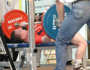 Konstantin Pavlov (RUS) bench pressing 167.5kg in the 56kg class at the 2002 Men's European Powerlifting Championships